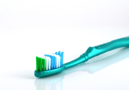 Tooth-brush over white. Shallow DOF. Stock Photo