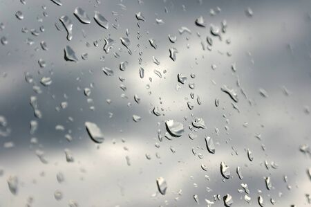 Drops of rain on the inclined window (glass). Shallow DOF. photo