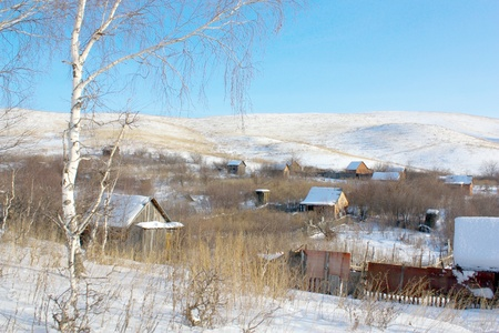 Houses in gardens under the hill, in winter. photo