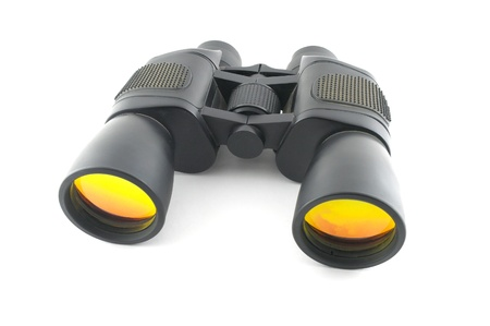 Black binoculars over white photo
