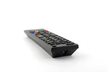 Old remote console for TV over white  photo