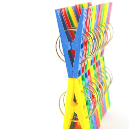 Color clothes-pegs over white. Shallow DOF. Stock Photo - 12395887