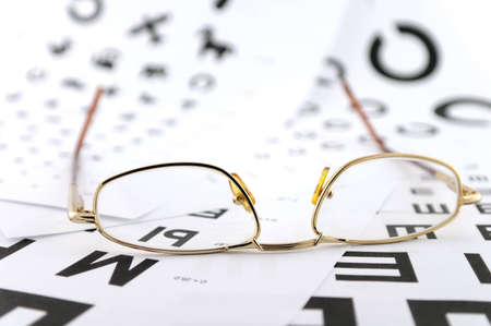 Eyeglasses on the ophthalmologic scales  Shallow DOF  Stock Photo - 12397252