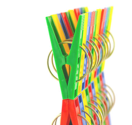 Color clothes-pegs over white. Shallow DOF. Stock Photo - 12758462