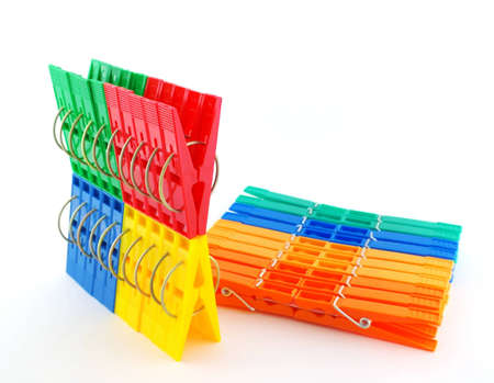 clothespegs: Set multi color clothes-pegs over white Stock Photo