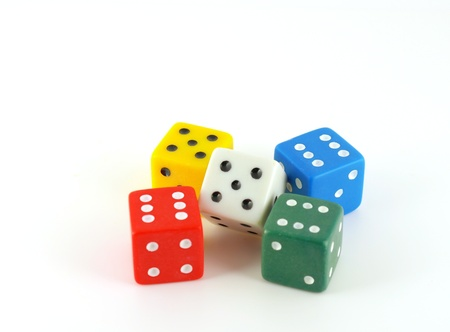 Five color dice over white photo