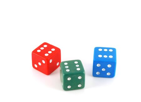 Three color dice over white photo