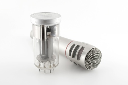 triode: Old glass triode (valve) and microphone over white