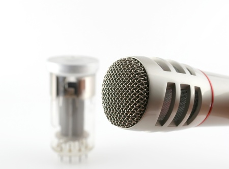 triode: Microphone and old glass triode  valve   Shallow DOF  Stock Photo