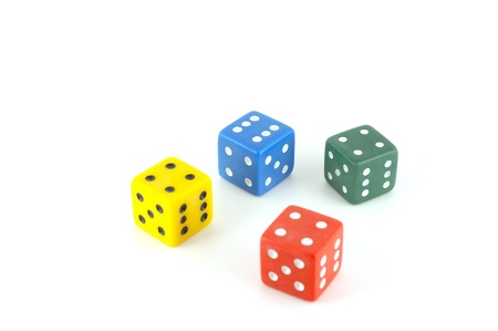 Four color dice over white photo