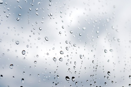 Water drops on the window. Shallow DOF. Abstract background. Stock Photo