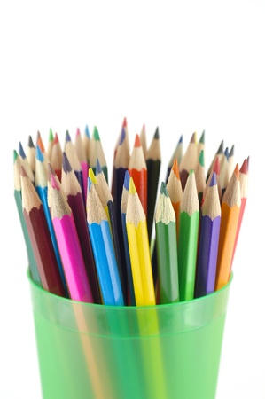Color pencils in the green prop over white. Shallow DOF. Stock Photo - 13396545