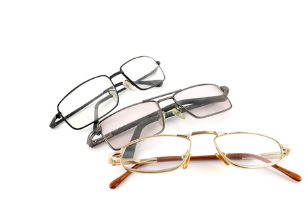 Three optical glasses over white