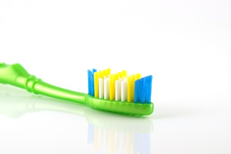 Tooth-brush with green handle over white. Shallow DOF Stock Photo - 13395996