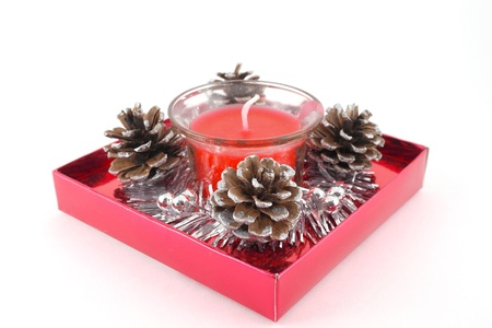 Christmas decoration with pine cone and candle photo