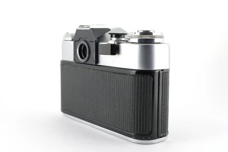 Old film camera without lens over white photo