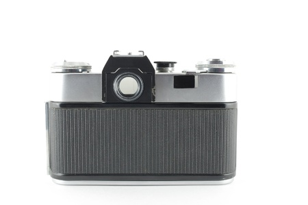 Old film camera over white photo