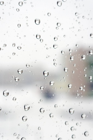 On a winter raining day  Drops of water on the window  Shallow DOF Stock Photo