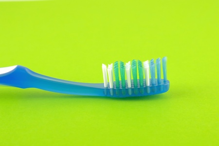 Tooth-brush over bright green photo