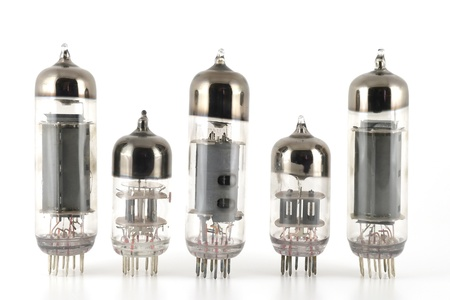 Vacuum radio tubes over white photo