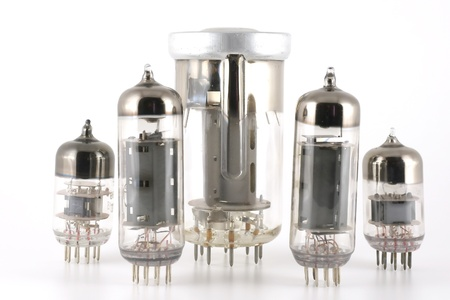 Glass vacuum radio tubes over white photo