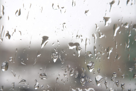 Rain drops on the window. Abstract background. Shallow DOF. photo