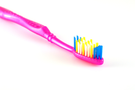 Tooth-brush over white. Shallow DOF. photo