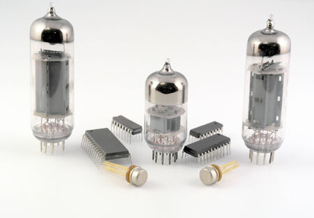 semiconductor: Vacuum radio tubes and semiconductor chips over white
