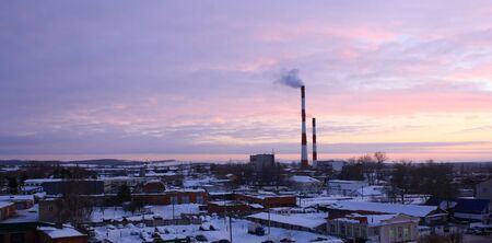 paesaggio industriale: Evening industrial landscape with factory chimneys