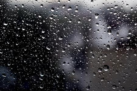 Drops of rain on the window, rainy day, dark tone. Shallow DOF Zdjęcie Seryjne