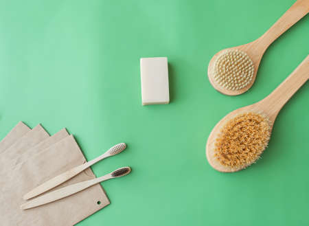 wooden brushes, tooth counters, body counters, natural soap, paper bags on a green background, zero waste