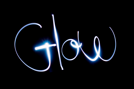 Light painting the word Glow. Stock Photo - 90674251