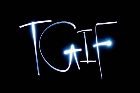 Light painting the letters TGIF. Stock Photo - 90660308