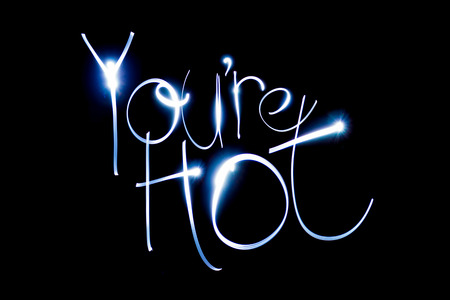 Light painting the words You're Hot. Stock Photo - 90596115
