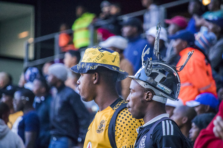 CAPE TOWN STADIUM, SOUTH AFRICA, 12 May 2018 - Diverse South African football supporters watching intensely during PSL football match between Ajax Cape Town and Kaiser Chiefs. Editorial