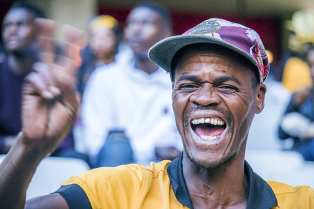 CAPE TOWN, SOUTH AFRICA, 12 May 2018 - Diverse South African football supporter cheering and celebrating during PSL football match between Ajax Cape Town and Kaiser Chiefs.