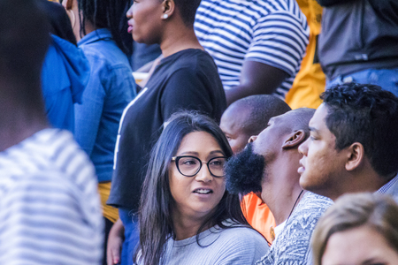 CAPE TOWN, SOUTH AFRICA, 12 May 2018 - Diverse South African football supporters in conversation during PSL football match between Ajax Cape Town and Kaiser Chiefs. Editorial