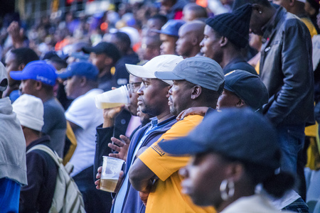 CAPE TOWN, SOUTH AFRICA, 12 May 2018 - Diverse South African football supporters watching intensely during PSL football match between Ajax Cape Town and Kaiser Chiefs.