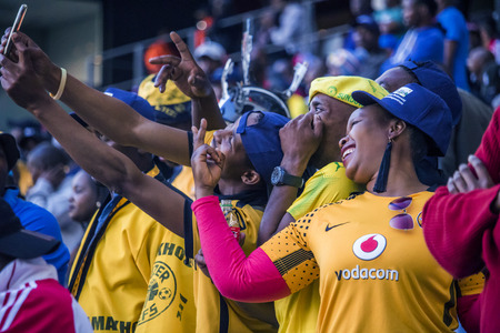 CAPE TOWN, SOUTH AFRICA, 12 May 2018 - Diverse South African football supporters taking a selfie during PSL football match between Ajax Cape Town and Kaiser Chiefs. Editorial