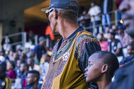 CAPE TOWN, SOUTH AFRICA, 12 May 2018 - Diverse South African football supporter and his son during PSL football match between Ajax Cape Town and Kaiser Chiefs.