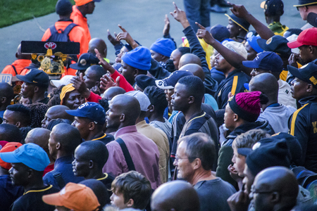 CAPE TOWN, SOUTH AFRICA, 12 May 2018 - Diverse South African football supporters arguing with a decision during PSL football match between Ajax Cape Town and Kaiser Chiefs. Editorial
