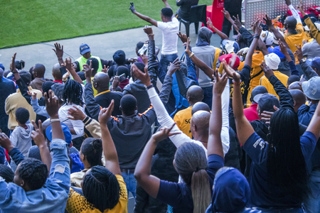 CAPE TOWN, SOUTH AFRICA, 12 May 2018 - Diverse South African football supporters cheering and celebrating during PSL football match between Ajax Cape Town and Kaiser Chiefs. Editorial
