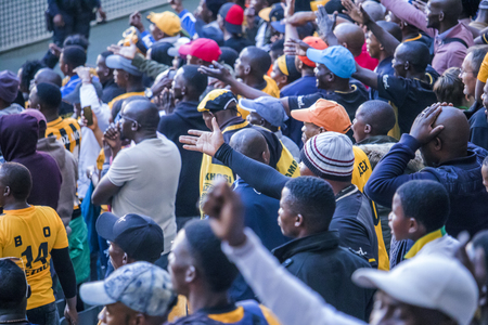 CAPE TOWN, SOUTH AFRICA, 12 May 2018 - Diverse South African football supporters disagreeing with a decision during PSL football match between Ajax Cape Town and Kaiser Chiefs.