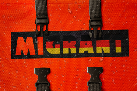 3D rendered idea for migrants crossing the Mediterranean and gaining access into Germany. Stock Photo