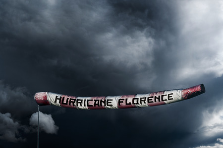 Photo manipulated image of a extra long windsock showing the power of Hurricane Florence. Stock Photo