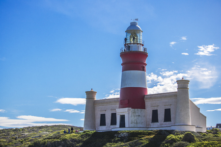 Close up of tourist landmark lighthouse on a hill in the Southern most point of Africa, Cape Agulhas.