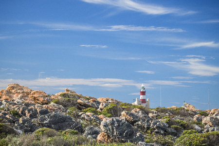 Tourist landmark lighthouse on a hill in the Southern most point of Africa, Cape Agulhas.