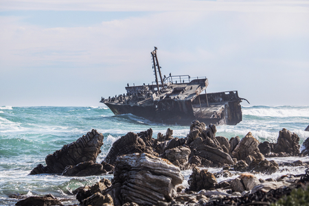 Waves crashing by a rusted old shipwreck. Home to Cormorants, sea gulls and other birds.