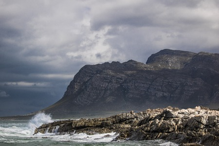 Scenic view of mountain and shoreline in Kleinmond, Western Cape, South Africa. Stock Photo