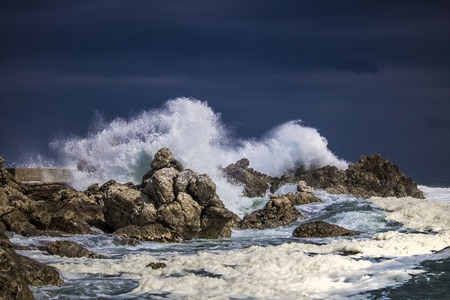 Dramatic big stormy crashing waves splash. Kleinmond, Western Cape, South Africa.